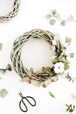 cotton bud: Wreath frame with cotton balls and eucalyptus branch on white background. Flat lay, top view.