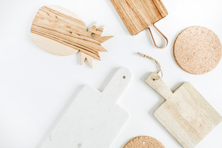 Cutting boards collection on white background. Flat lay, top view.