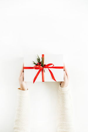 Christmas concept. Woman holding gift box. Flat lay, top view.