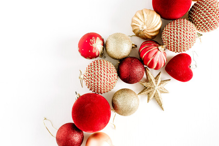 Christmas ornamentation baubles. Flat lay, top view holiday background. Фото со стока