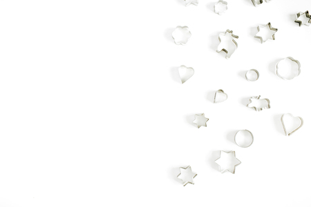 Christmas baking molds on white background. Flat lay, top view bakery composition.
