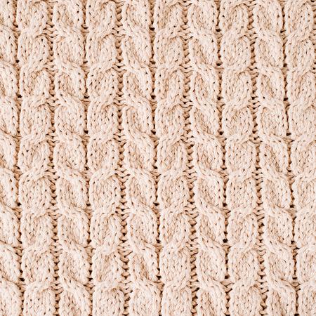 Beige gebreide wol textuur patroon. Stockfoto