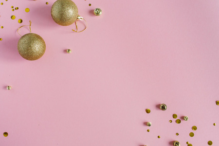 Christmas baubles on pink background. Flat lay, top view holiday background.