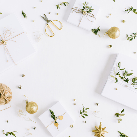 Frame of handmade Christmas gift boxes and festive decoration on white background. Flat lay, top view holiday composition.
