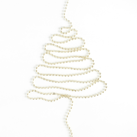 Christmas tree made of golden garland on white background. Flat lay, top view minimal holiday concept. Stok Fotoğraf