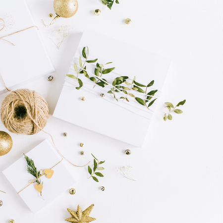 White handmade Christmas gift boxes. Flat lay, top view holiday composition. Stock Photo