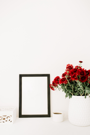 Photo frame mock up, beautiful red flowers bouquet, white vintage casket in front of white background. Blog, website composition.