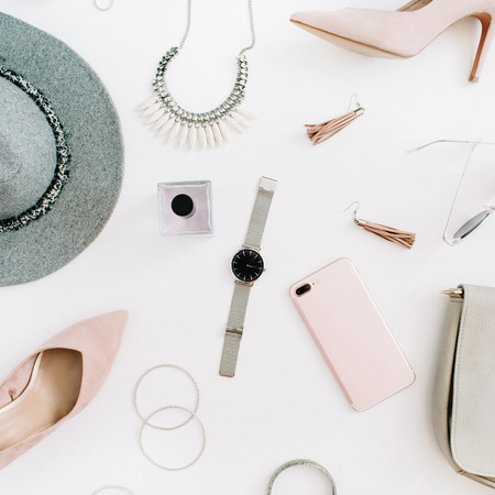 Women modern fashion clothes and accessories on desk. Flat lay female casual style look. Top view.
