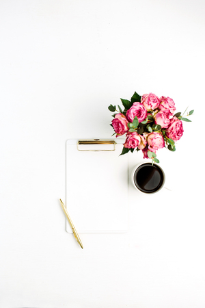 Clipboard, rose flowers bouquet, coffee and pen on white background. Flat lay, top view minimal festive mockup with space for text.