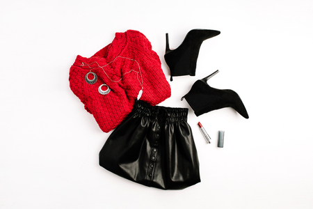 Female fashion clothes. Red sweater, black skirt, shoes and lipstick. Flat lay, top view woman look. Фото со стока