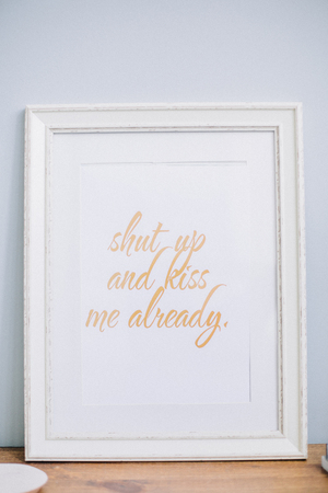 Photo frame with quote Shut up and kiss me already. Mock up. Stock Photo - 97850206