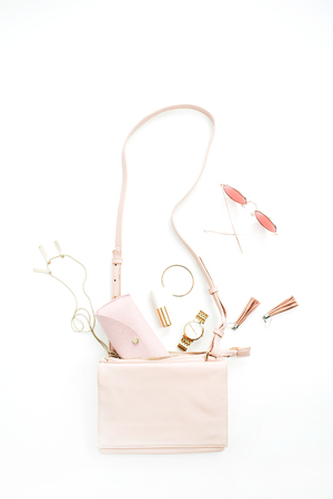 Woman fashion trendy accessories set: purse, sunglasses, watch, bracelet, necklace, lipstick, earrings on white background. Flat lay, top view stylish pastel pink concept. Stock Photo
