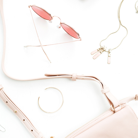 Pale pastel pink female accessory collection on white background. Flat lat, top view of sunglasses, clutch, necklace, bracelet, watch. Minimal concept. Banco de Imagens