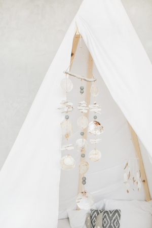 Decorative boho styled cozy hut with seashell decor. Minimal home interior design.