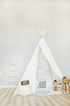 Decorative boho styled cozy hut with decor. Minimal home interior design. Stock Photo