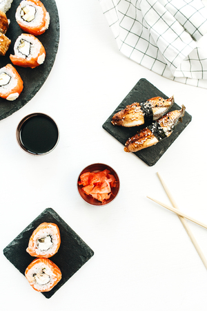 Sushi rolls on white background. Flat lay, top view.