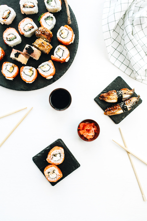 Sushi and nigiri on white background. Flat lay, top view.