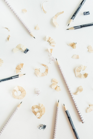 Pencils and shavings on white background. Flat lay, top view art concept. 版權商用圖片