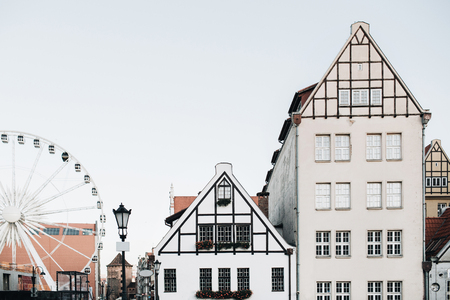 View of buildings in Old Town of Gdansk, Poland. Architecture of Eastern Europe. Ferris and cute traditional houses.