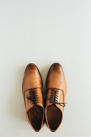 Men's leather shoes. Flat lay, top view fashion background
