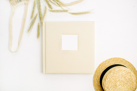 Wedding or family photo album, rye ears, straw. Flat lay, top view mock up background.