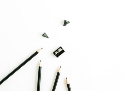 Pencils and sharpener on white background. Flat lay, top view painter concept. Archivio Fotografico - 110370055