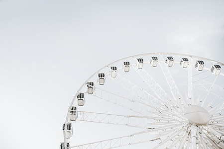 Ferris wheel on sky background. Stock Photo