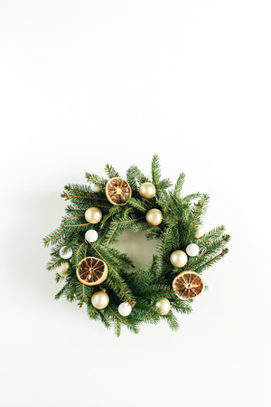 Christmas, New Year wreath frame made of fir branches decorated with dried oranges and Christmas balls. Flat lay, top view.
