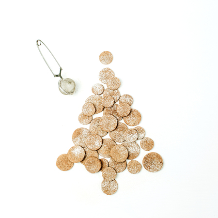 Christmas tree made of gingerbread cookies on white background. Flat lay, top view Christmas  New Year food creative concept.