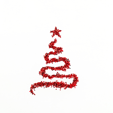 Christmas fir tree symbol made of red glitter sparkles tinsel isolated on white background. Flat lay, top view Christmas, New Year, Winter creative concept. Фото со стока - 111688902
