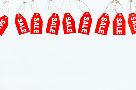 Black Friday sales discount composition. Red tags with word SALE on white background. Flat lay, top view. Foto de archivo - 111688903