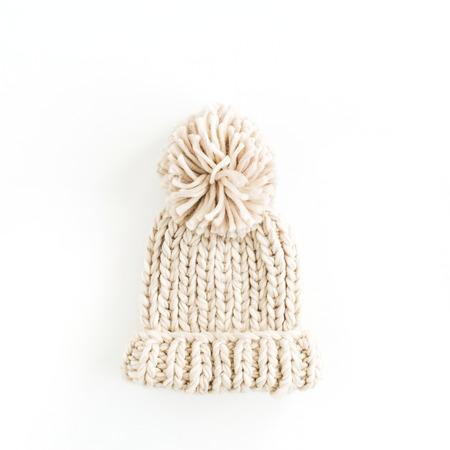 Warm female knitted hat isolated on white background. Flat lay, top view minimal fashion concept. Archivio Fotografico - 112604498