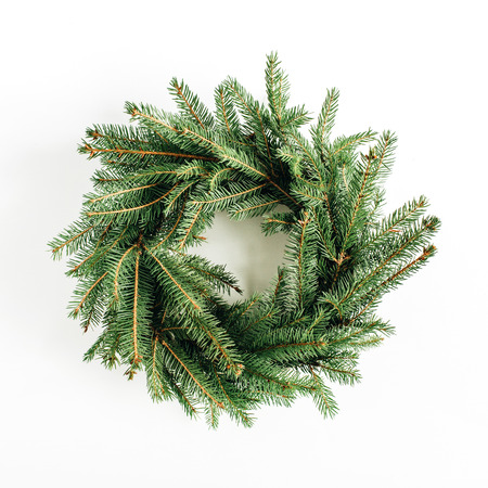 Christmas, New Year wreath frame made of fir branches on white background. Flat lay, top view blog hero header.
