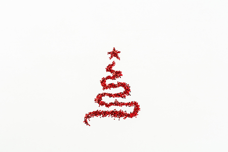 Christmas fir tree symbol made of red glitter sparkles tinsel isolated on white background. Flat lay, top view Christmas, New Year, Winter creative concept. Фото со стока - 112605165