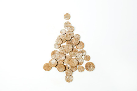 Christmas tree made of gingerbread cookies on white background. Flat lay, top view.