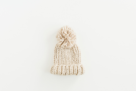 Warm knitted hat isolated on white background. Flat lay, top view. Archivio Fotografico - 112605266