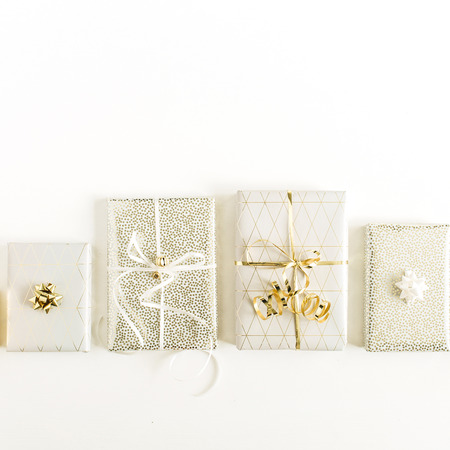 Christmas, New Year gift presents on white background. Flat lay, top view holiday composition. Фото со стока