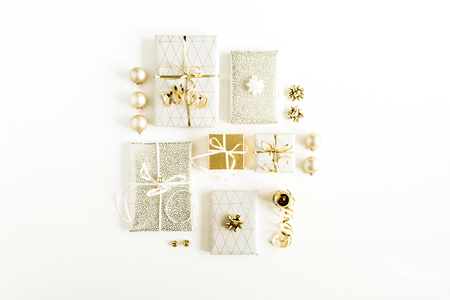 Christmas gifs on white background. Flat lay, top view festive composition. Christmas / New Year holiday concept.