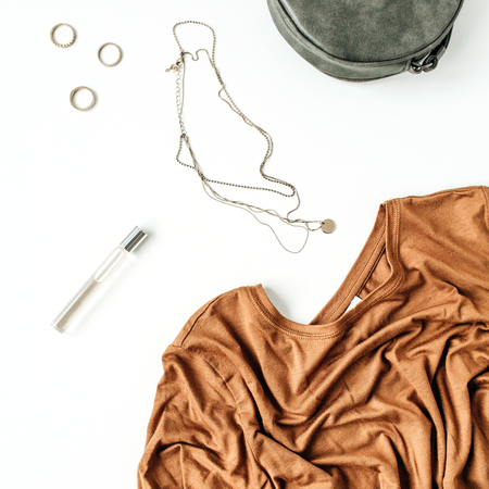 Fashion flatlay of modern female clothes and accessories on white background. Flat lay, top view. Stock Photo
