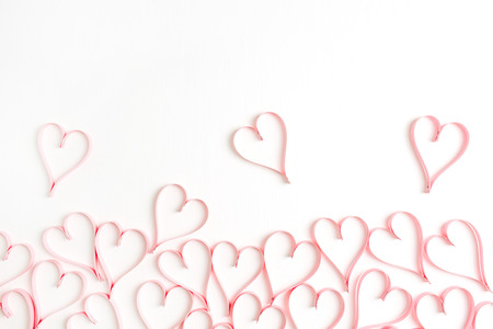 Pink hearts on white background. Flat lay, top view Valentines Day background love concept. Stok Fotoğraf