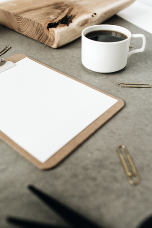 Clipboard with empty space screen mock up. Home office desk workspace.
