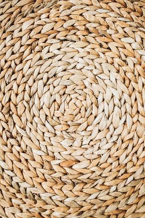 Round traditional wicker straw texture pattern.