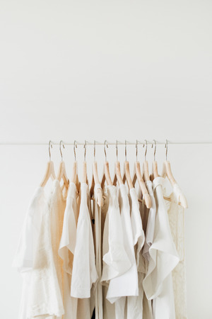 Feminine clothes on hanger. Minimal fashion composition on white background. Lifestyle concept.