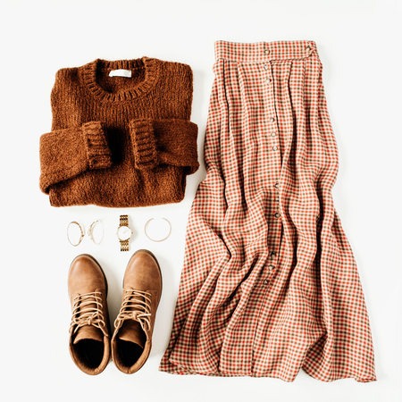 Fashion clothes look composition with brown sweater, shoes, skirt on white background. Flat lay, top view. Фото со стока
