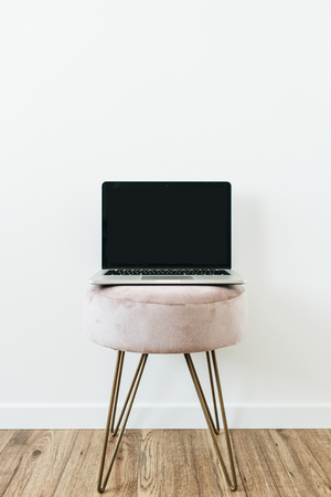 Laptop on stool. Copy space mockup template on white background. Minimalist blog, website, social media hero header template.