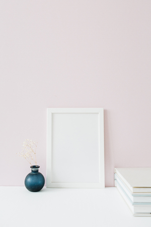 Mock up photo frame with blank space on pink background. Front view minimalist blog, website, social media hero header. 写真素材