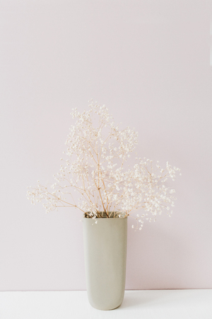 White flowers bouquet on pink background. Minimal floral composition.