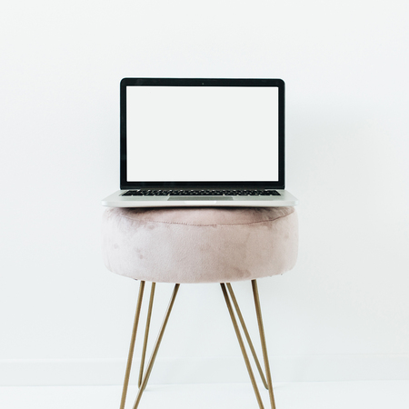 Minimal composition with blank screen laptop on white background. Stylish home office concept. Blog hero header template mock up. Reklamní fotografie