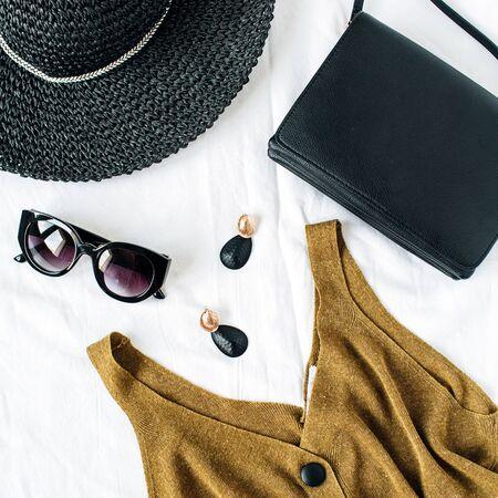 Feminine fashion blog composition on white background. Flat lay, top view minimalist stylish trendy elegant clothes collage. Stock Photo