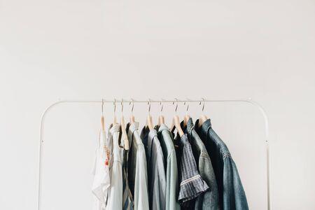 Minimal fashion concept. Female clothes on hanger on white background. Fashion blog, website, social media hero header template.